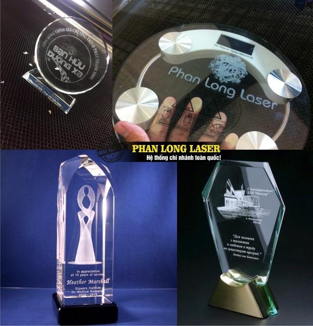 Sử dụng máy laser để khắc nội dung, khắc logo theo yêu cầu lên cúp và kỷ niệm chương bằng pha lê và bằng thủy tinh